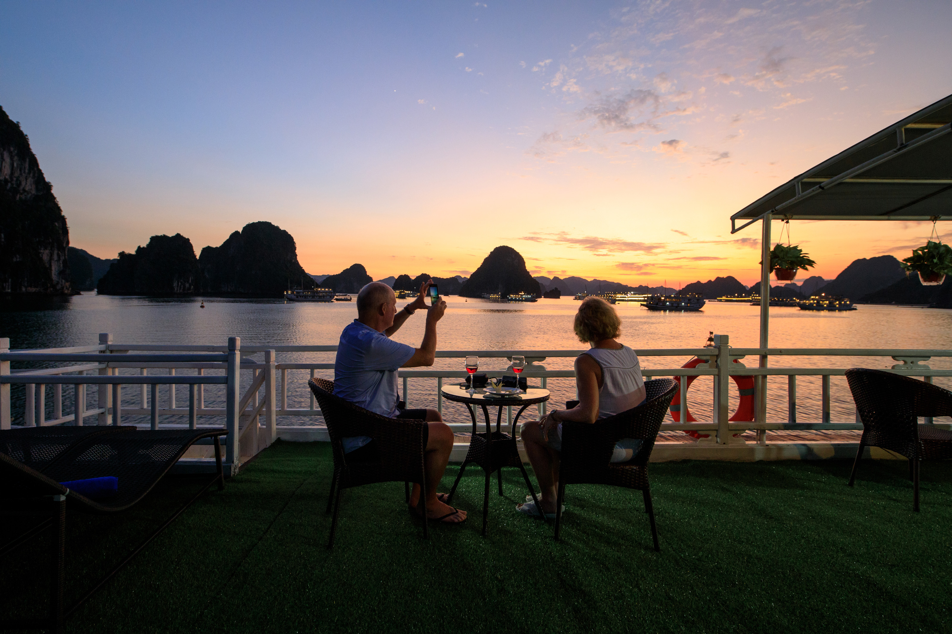 Halong Bay weather sunset party with cozy bay cruise